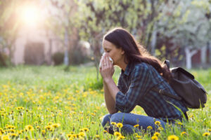 Woman suffering from allergies in the springtime
