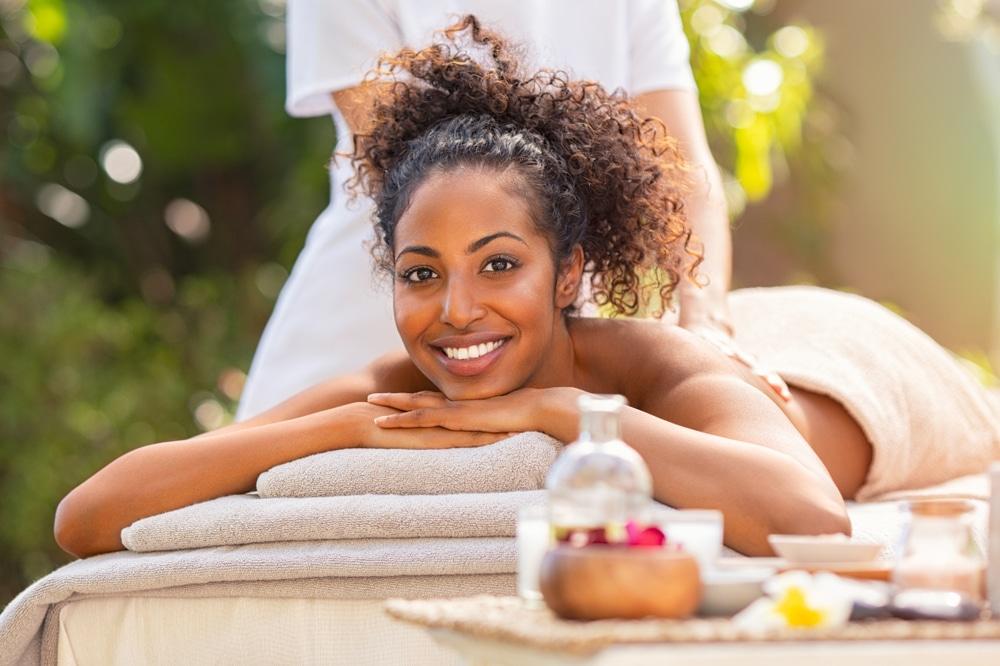 Young woman getting a CBD massage